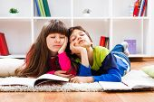picture of homework  - Little girl and little boy  fell asleep while they were doing their homework - JPG