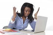 foto of frustrated  - black African American ethnicity tired and frustrated woman working as secretary in stress at work office desk with computer laptop desperate in business frustration concept - JPG