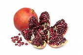 pic of pomegranate  - Pomegranates and pomegranate grains and isolated on white background - JPG