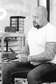 Постер, плакат: Tattoo Artist Putting On The Gloves