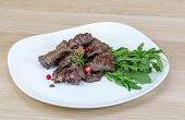 image of deer meat  - Roasted venison meat with ruccola and cranberries - JPG