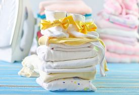 picture of girlie  - baby clothes on the blue table - JPG
