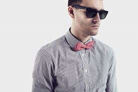 pic of bowing  - Young man hipster  with red bow - JPG