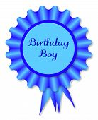 stock photo of rosette  - Blue rosette with the legend birthday boy over white - JPG