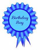 stock photo of rosettes  - Blue rosette with the legend birthday boy over white - JPG