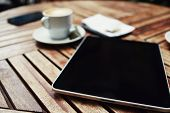 picture of blank check  - Wooden table with empty blank screen tablet cup of coffee cell phone and bill check with money business work break - JPG