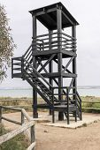 image of observed  - black observation tower overlooking lake in Spain
