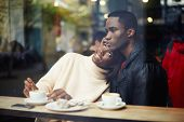 stock photo of san valentine  - Portrait of young beautiful couple in love having coffee in beautiful cafe two people in cafe enjoying the time spending with each other - JPG