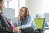 picture of office romance  - Loving business couple looking at each other in office - JPG