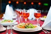picture of banquet  - Served banquet table with glasses and salads - JPG