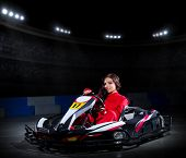 stock photo of karts  - Young girl karting racer at stadium - JPG
