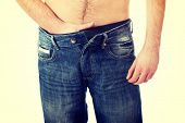 pic of crotch  - Young shirtless man holding his crotch because of pain - JPG