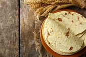 picture of whole-wheat  - Stack of homemade whole wheat flour tortilla on plate - JPG