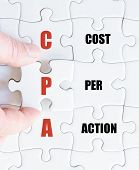 pic of cpa  - Hand of a business man completing the puzzle with the last missing piece - JPG