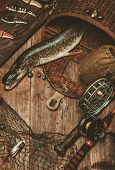 picture of fishing bobber  - Fishing tools and fresh pike on a wooden table - JPG