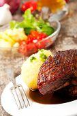 picture of roasted pork  - closeup of a bavarian roast pork dish  - JPG