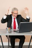 picture of chokers  - Senior man scaring while working with laptop at the office - JPG