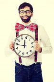 foto of suspenders  - Funny man wearing suspenders holding big clock - JPG