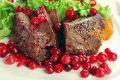 pic of deer meat  - Tasty roasted meat with cranberry sauce on plate - JPG