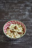 stock photo of pecan  - cottage cheese with honey and pecans in a bowl on a vintage dark brown wooden background - JPG