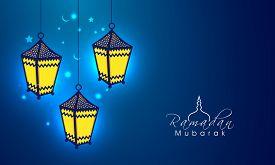 stock photo of ramazan mubarak  - Creative hanging lanterns on stars and crescent moons decorated shiny blue background for Islamic holy month of prayers - JPG