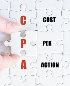 foto of cpa  - Hand of a business man completing the puzzle with the last missing piece - JPG