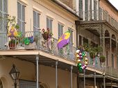 pic of mardi-gras  - Beads and Decorations hanging from a balcony in New Orleans - JPG