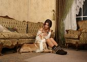 Attractive woman with the dog in the luxury interior