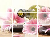 picture of massage oil  - Bottle of massaging oil over spa background - JPG