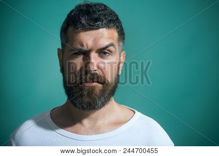 poster of Handsome Serious Fashion Man Portrait. Portrait Of Charismatic Man With Beard&mustache In Casual T-s