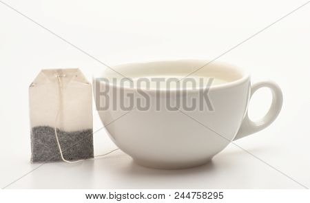 poster of Mug Filled With Boiling Water And Teabag On White Background. Cup Or White Porcelain Mug With Transp
