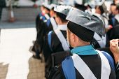 Successful Graduates In Academic Dresses, At Graduation, Sitting In The Form Of Graduates, Can Be Us poster