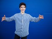 Teenager On A Blue Background Going To Hug Another Person poster