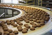 Production Line Of Baking Cookies. Biscuits On Conveyor Belt In Confectionery Factory, Food Industry poster