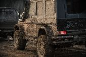Racing On Off-road Cars. Dirty Offroad Cars On Dark Background, Back View. Suv Covered With Mud With poster