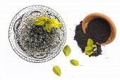 Soaked Sweet Basil Or Tukhmaria Or Falooda Seeds Or Sabja Seeds In A Bowl With Raw Sweet Basil Seed  poster