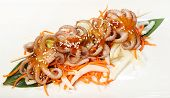 Mini Kebabs On Skewer With Mini-octopuses And Leek, Served In Teriyaki Sauce, With Beijing Cabbage,  poster