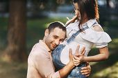 Parents, Love, Happiness, Maternity, Family Concept Happy Man Hugging Pregnant Wife poster