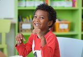 African American Ethnicity Kid Smiling At Library In Kindergarten Preschool Classroom.happy Emotion. poster
