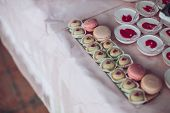 Delicious Sweets On Candy Buffet. Wedding Candy Bar With A Lot Of Colorful Macaroons And Another Des poster