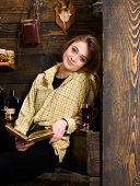 Relaxation Concept. Girl In Casual Outfit Sits With Book In Wooden Vintage Interior. Girl Student Re poster