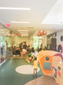 Blurred Playroom Kid Corner At Public Library In Usa poster