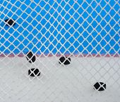 Closeup View Of Nylon Netting. Color Patterns In The Background, These Are Logos On Hockey Ice. The  poster