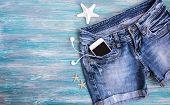 Denim Shorts, Mobile Phone, Headphones, Shells poster