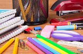 Closeup Of An Assortment Of School And Office Supplies On A Wooden Surface poster