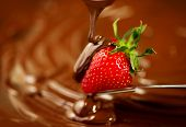 Strawberry in chocolate over swirl brown background. Melted Chocolate pouring on fresh ripe juicy st poster