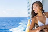 Beautiful Asian bikini tourist woman on luxury travel cruise vacation relaxing in swimwear for swimm poster
