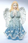 stock photo of cherubim  - Isolation of a Christmas angel holding ! ** Note: Slight blurriness, best at smaller sizes - JPG