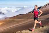 Trail running runner man on endurance run with backpack on volcano mountain. Ultra marathon race ath poster