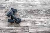 Training at home fitness concept: dumbbell weights on wood floor at fitness gym . Weight loss and he poster